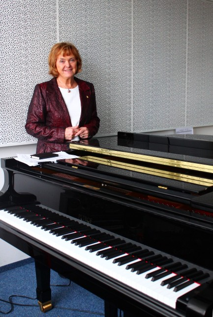 Mrs. Dagmar Petrofová, the Head of PETROF Pianosalon, with PETROF pianos bought by Conservatory.